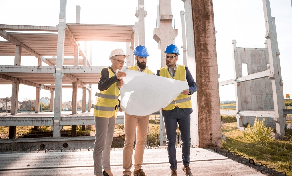 Three Architectural Design Specialists Working with a Drawing
