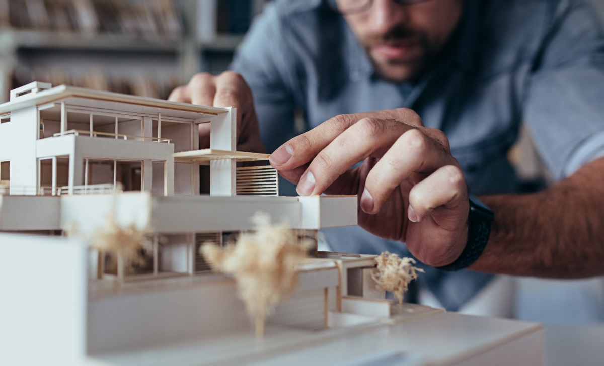 An Architecture Specialist Creating a Physical Model of a House