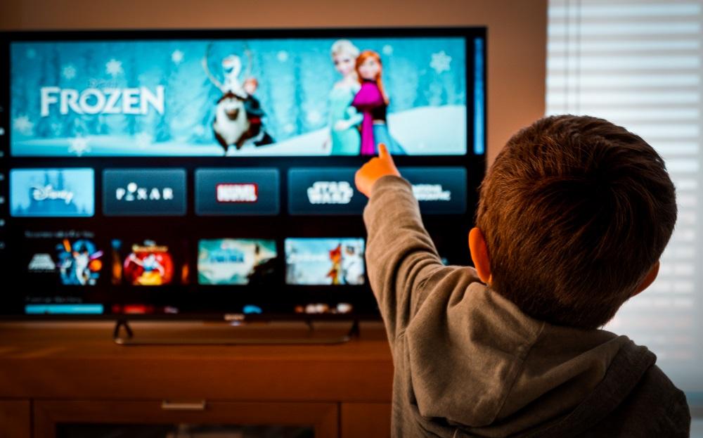 Child Choosing a Movie to Watch