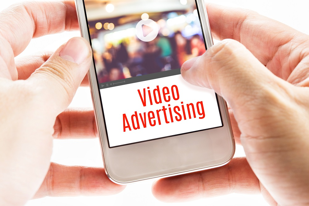 Person Looking at Video Ads on a Smartphone