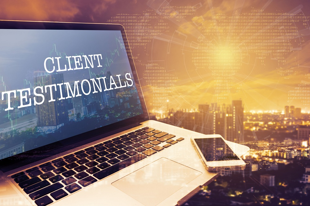 Using a Laptop to See Client Testimonials