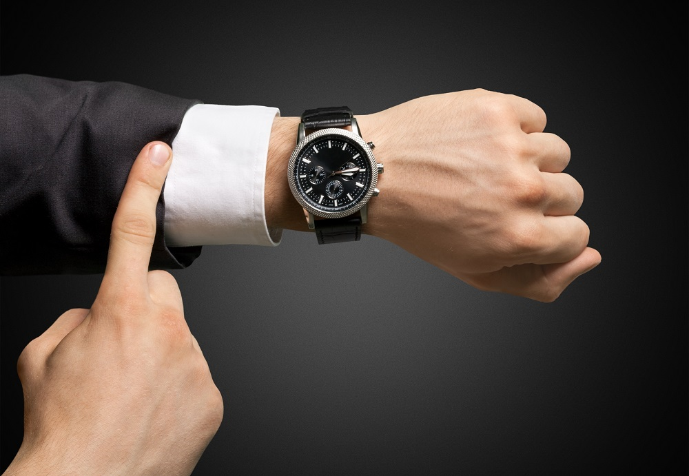 An Architect Pointing at a Watch